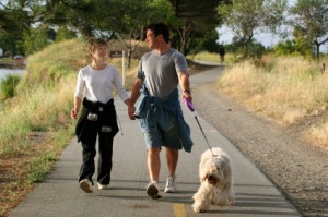 Couple walking their dog near their pet-friendly lodging