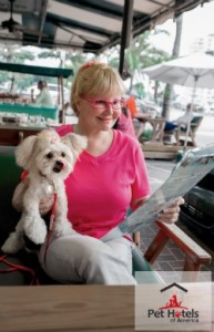 Woman with pet at a dog friendly restaurant